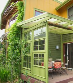 A porch wall made from recycled windows.... fun n' nearly free!