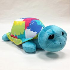 A sweet soft friend for your little one. This stuffed turtle, in a cheerful shade of blue, is topped with a colorful tie dyed soft shell. Soft and fuzzy, our turtle is a great gift idea!