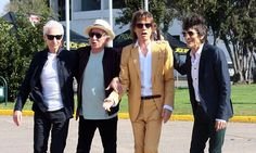 Mick Jagger in yellow pinstripe suit ahead of Rolling Stones tour