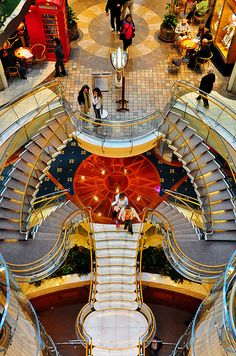 Look down. The view from the elevator lobby gives a great perspective of the grand staircase onboard Voyager of the Seas.