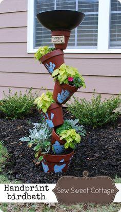 Handprint birdbath planter with terra cotta pots
