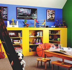 Because basements are often used for entertaining, bright colors can add a fun twist that is perfect for children. Here, vivid colors cover the walls and shelving to create a fun and unique atmosphere. The storage space is painted in a brilliant yellow that is a beautiful contrast from the blue and green adorning the walls. The open shelves are ideal for organizing clutter and housing games. For easy access for children, be sure that the shelves are low enough for them to reach.