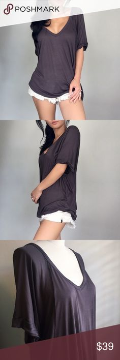 """3 COLORS// Bane Roll Up T ✨RESTOCKED✨This is lightweight, breathable, soft & lays on your body beautifully. High low hem, wide V neckline with pretty statement hourglass seams. My favorite is the cute rolled up vintage sleeves. Available in Charcoal, Grey & Black.   Modeling: S/M Material: Rayon Fit: Loose & Relaxed Measurements (S/M) Laying Flat: 24""""Waist 27""""Front Hem 32""""Longest Back Hem  ▪️Use the """"Buy Now"""" or """"Add to Bundle"""" feature to purchase""""▪️ Tops Tees - Short Sleeve"""