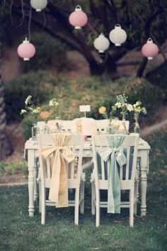 love the big fabric bows on the backs of the chairs.
