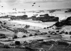 Allied troops unload equipment and supplies on Omaha Beach in Normandy, France, in early June of 1944. (U.S. Army photo)