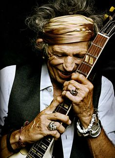 Keith Richards has distinctive hands.