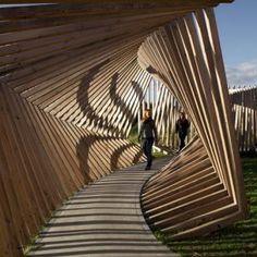 "EKKO by  Thilo Frank (""Visitors to this installation in northern Denmark by German artist Thilo Frank are invited to walk through a contorted loop of timber while listening to the sounds of their voices and footsteps played back to them"")"
