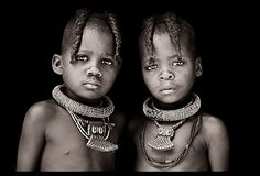 African girls adorned with traditional jewellery and braided hair.