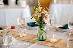 Centerpieces with mason jars and burlap