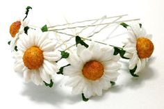 I love daisies. Like daffodils, theyre a pretty, optimistic sign that springs here and summer is coming. I have made four pins to each set,