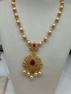 22 carat gold metal intricate south sea pearls long chain with two step uncut diamond pendant. Studded with flat diamonds, pink rubies ac. Gold Jewellery Design, Bead Jewellery, Pendant Jewelry, Beaded Jewelry, Jewelery, Gold Jewelry, Temple Jewellery, Gold Necklace, Pearl Jewelry
