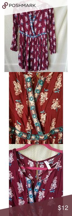 Maroon blue floral long sleeve dress wrap front Xhilaration maroon and blue floral long sleeve dress with wrap front. Cinched waist. Neckilne features blue embroidered round mirrored accents. Size M Xhilaration Dresses Long Sleeve