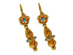 Georgian Turquoise Day Night Earrings. Amazing Georgian era 18k yellow gold earrings show off the style of day night earrings. Composed of two elements, the surmount can be separated from the dangle and worn separately.  The top is a flower cluster set with a half cabochon of Persian turquoise. It suspends an elongated pendant drop accented with six (6) turquoise half cabochons. Lovely repoussé work displays the masterful craftsmanship of the 1800s... c 1830