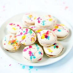 Use edible food paint to make these adorable splatter painted French Macarons! Plus, a recipe with step by step photos for plain french macaron shells.