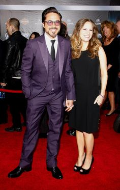Robert Downey Jr & Susan Downey - Amethyst to honor Exton (it's his birthstone) it's a great color for him, and her simply lovely dress really compliments his more striking suit.