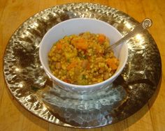 A blog posting about trying Israeli couscous for the first time, using it to turn lentil-vegetable soup into a savory pasta dish.