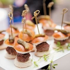 Brides: Mini Kobe Beef Burgers. The couple and their 175 guests enjoyed cocktails and passed hors d'oeuvres like mini Kobe beef burgers and crab cakes on the restaurant's rooftop terrace before heading down to the main dining room for the reception.