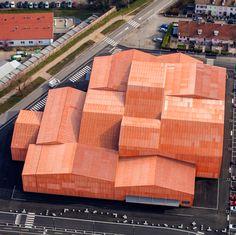 Manuelle Gautrand divides exhibition centre into 13 orange-hued blocks