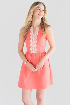 Crochet details make the Audrina Crochet Dress special. A crochet trim decorates the bodice of this coral fit & flare dress. Style with wedges & a clutch for a fashionable spring look.