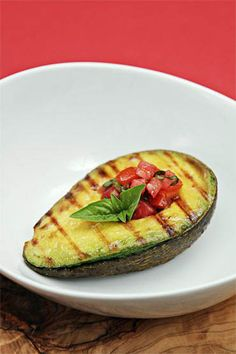 I never would have thought to do this!! Grilled avocados with tomato-basil salsa