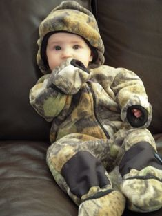HOLY JESUS!!! Camo onesie, OMG SOOOOOOO   getting this for my baby boy and a pink camo one for my baby girl   :)