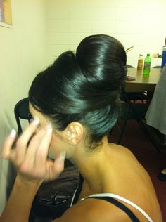 "Wedding chignon. I usually make a ""centerpiece"" out of cotton filled pantyhose before hand in the shape you desire. Pin the piece above the ponytail and tease the hair. Smooth and place the hair over the piece and pin in a criss-cross horizontal line with extra-long bob pin. Tease the remaining hair and smooth over the piece and fold under edges and pin."