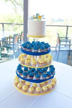 Blue and Yellow cupcake tower for a wedding with swirl buttercream cake on top