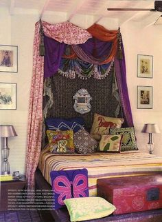 drapes/scarves over bed can make for an inexpensive headboard with a very dramatic effect!