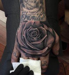 No photo description available. Skull Rose Tattoos, Skull Hand Tattoo, Rose Hand Tattoo, Rose Tattoos For Men, Hand Tattoos For Women, Black Rose Tattoos, Body Art Tattoos, Wolf Tattoo Sleeve, Best Sleeve Tattoos