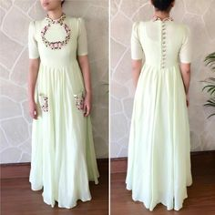 Elegant greenish whiteish shade amd the flower boundary design on the neck. Indian Gowns, Indian Attire, Indian Ethnic Wear, Pakistani Dresses, Indian Outfits, Indian Style, Kurta Designs, Blouse Designs, Dress Designs