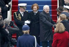 Former President Jimmy Carter and his wife Rosalynn arrive for the swearing-in ceremonies for President Barack Obama