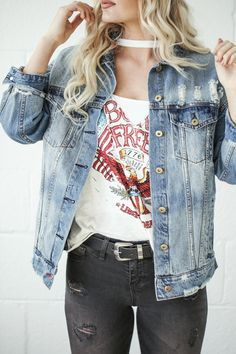 Upgrade your graphic game with a v-neck cut out tee, distressed denim jacket, and black jeans!