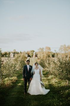 The perfect wedding day stroll in the apple orchard. #orchardwedding #farmwedding #ThePavilion #photoenvy