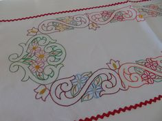 A very pretty hand embroidered antique French linen table centre mat, embroidered with a distinctive art deco design.