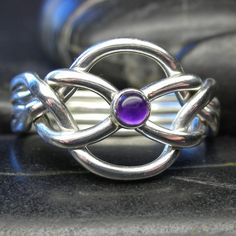 Puzzle ring with amethyst