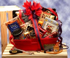 A gift basket for the man who is your Jack of All Trades! Make his job and his day go smoother with this all-purpose tote box filled with sweet and savory snacks to be enjoyed either on the job or aft