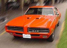 1969 Pontiac GTO. Orange is so popular for this model, and I see why! Sexay.