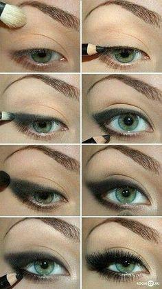 Blending eyeliner with makeup brush.