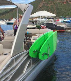 paddleboard storage rack on pontoon boat