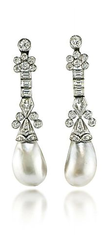A PAIR OF ART DECO NATURAL PEARL AND DIAMOND EAR PENDANTS Each as a kite-shaped, circular and baguette-cut diamond line suspending an associated baroque drop-shaped natural pearl, 1920s, 5.2 cm