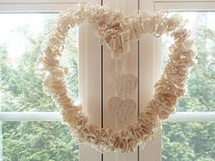 Cut an old crocheted runner into strips, feed onto wire and shape into a heart!