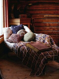 inviting cozy chaise lounge with crochet pillow and afghan