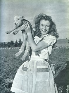 Norma Jeane holding a lamb, 1945. Photo by Andre de Dienes.