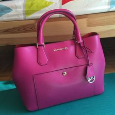 $100 off TODAY ONLY!!!! MK a Greenwich large Satchel PRICE UNTIL 12AM TODAY. Deducted from $280 to $180!!! Maroon leather lining. Beautiful amazing piece. Guarantee authentic. With strap. Outside color is red violet and inside is maroon red lining. 100% leather. Can be shaped into different ways. NO TRADES. Offers welcome! 100%%%% NEW Michael Kors Bags Satchels