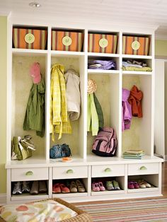 I like the cubbies, drawers, shoe storage on this - Adam is going to build a piece to go in place of our changing table in the near future. But, obviously the color would be different and we need a bench for little boys to put on their shoes :-)