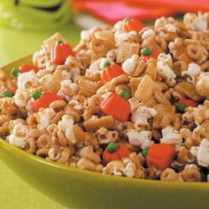 Pumpkin Snack Mix Recipe - popcorn, Cheerios, Chex, peanuts, candy pumpkins all covered with a sugary sweetness.