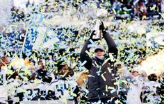 Seattle Seahawks owner Paul Allen lifts the Vince Lombardi Trophy during a rally on Wednesday, Feb. 5, 2014, in Seattle. The Seahawks defeated the Denver Broncos on Sunday in NFL football's Super Bowl XLVIII game in East Rutherford, N.J.