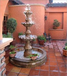 Mexican fountain and beautiful satillo tile courtyard. I love tile and fountains, would be perfect for my dream home. Mexican Courtyard, Spanish Courtyard, Mexican Hacienda, Mexican Patio, Mexican Style, Spanish Patio, Mexican Garden, Spanish Style Homes, Spanish Revival