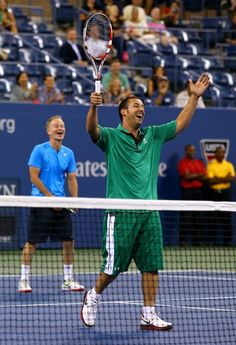 NEW YORK, NY - SEPTEMBER 06: Actor Adam Sandler reacts next to former tennis player John McEnroe during a celebrity doubles match on Day Eleven of the 2012 US Open at USTA Billie Jean King National Tennis Center on September 6, 2012 in the Flushing neighborhood of the Queens borough of New York City. (Photo by Al Bello/Getty Images)