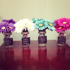 Flower pens in assorted colors! DIY Spring Party/ Table Decor - favor  Great for table decor for your Mothers Day get together. And makes for a cute favor as well. Inexpensive and easy enough kids can help to make them. These are in mason jars with chalkboard labels. Looks great in any vase or basket you may already have.  Great craft to do with children.